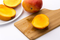 Juicy Mango Slice On A Wooden Cutting Board Stock Images