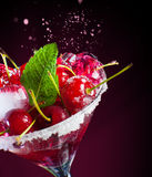 Juicy maraschino cherry on a black background. Royalty Free Stock Photo
