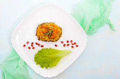 Juicy meat cutlet, baked with grated potatoes and cheese on a white ceramic plate Stock Image