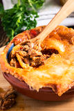 Juicy meat pot pie in a ceramic oven pot Royalty Free Stock Photos