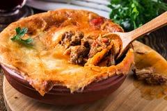 Juicy meat pot pie in a ceramic oven pot Stock Image