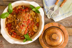 Juicy meatloaf in a casserole served with clean napkin and forks Royalty Free Stock Photography