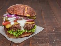 Juicy, meaty, delicious cheeseburger Stock Image