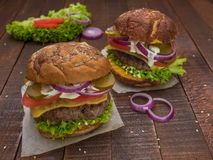 Juicy, meaty, delicious cheeseburgers Royalty Free Stock Image