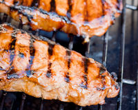 Juicy New York strip steak on a grill Stock Images
