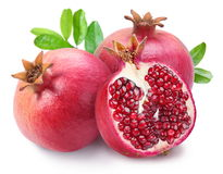 Juicy opened pomegranate with leaves. royalty free stock image