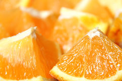 Juicy orange. Cut into sections Royalty Free Stock Image