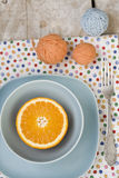 Juicy orange on blue plate for breakfast and bright balls Royalty Free Stock Image