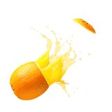 Juicy orange is exploding. Cut out from white background Stock Photos