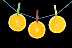 Juicy orange hanging on the rope Stock Images