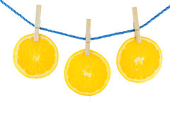 Juicy orange hanging on the rope Royalty Free Stock Photography