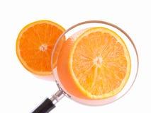 Juicy orange through loupe Royalty Free Stock Photos
