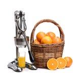 Juicy orange and a manual mechanical squezeer. Isolated on white background stock image