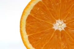 Juicy Orange Slice. A fresh orange slice on white background Stock Images