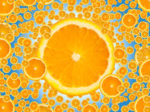 Juicy Orange Slices. Slices of juicy orange on blue background. Please visit my portfolio for more Stock Photos