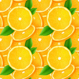 Juicy orange slices with green leaves seamless Stock Images