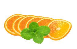 Juicy orange slices and mint herb isolated on white Royalty Free Stock Photography