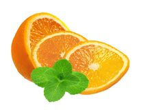 Juicy orange slices and mint herb isolated on white Royalty Free Stock Image