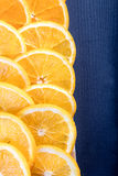 Juicy orange slices on navy blue board Royalty Free Stock Images