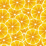 Juicy orange slices seamless background. Royalty Free Stock Images