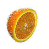 Juicy orange with water splash, isolated on background Royalty Free Stock Photography