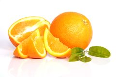 Juicy Oranges. Whole and cut Stock Photos
