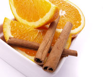 Juicy oranges and cinnamon Stock Photo