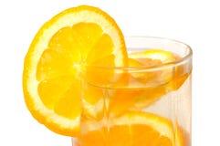 Juicy oranges in glass. Juicy oranges in glass on isolated background royalty free stock photo