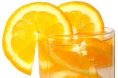 Juicy oranges in glass. Juicy oranges in glass on isolated background royalty free stock photography