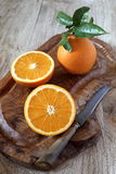 Juicy oranges with leaves Royalty Free Stock Photography