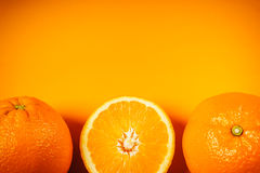 Juicy oranges on an orange background Royalty Free Stock Images
