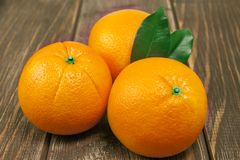 Juicy oranges on wooden table Royalty Free Stock Photo