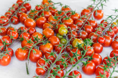 Juicy organic Cherry tomatoes  over white background Royalty Free Stock Photo
