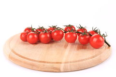 Juicy organic cherry tomatoes on platter. Stock Images