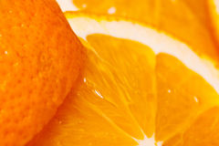 Juicy parts of orange and skin. Royalty Free Stock Photo
