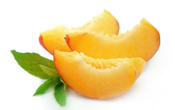 Juicy peach slices with mint Royalty Free Stock Photo