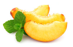Juicy peach slices with mint Stock Photography