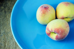 Juicy peaches  in ceramic plate Royalty Free Stock Images