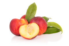 Juicy peaches on a white background. Juicy fresh peaches on a white background Royalty Free Stock Image