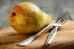Juicy pear on a cutting board. Stock Image