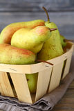 Juicy pears in wooden box Stock Images