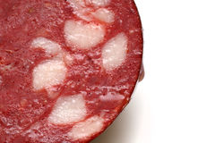 Juicy piece of sausage ckose up. Juicy piece of sausage isolated on white background Royalty Free Stock Images