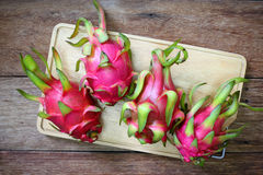 Juicy pink pitaya on wooden table Royalty Free Stock Photo