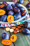 Juicy  plum on a wooden board, vertically Stock Photography