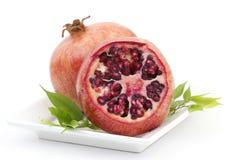 Juicy pomegranate. Juice pomegranate on a plate stock photos
