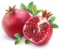Juicy Pomegranate And Its Half With Leaves. Stock Photography
