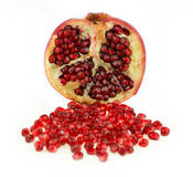 Juicy pomegranate fruit with seeds  against white Royalty Free Stock Images