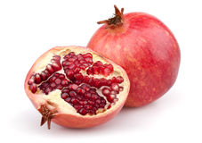 Juicy pomegranate and half Royalty Free Stock Image