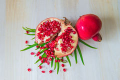 Juicy pomegranate. And its half with leaves stock image