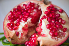 Juicy pomegranate. And its half with leaves stock images